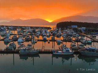 Alaska, Cordova harbor, Sunset, fishing boats, reflecting sun