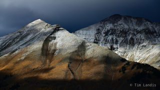 Winter approaches, contours, earth tones, snowy peaks