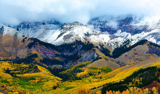 Mountains with snow, aspens with gorgeous leaves below.