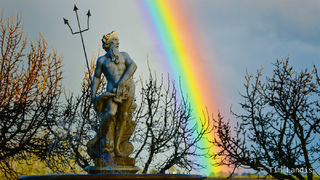 Neptune statue with massive rainbow