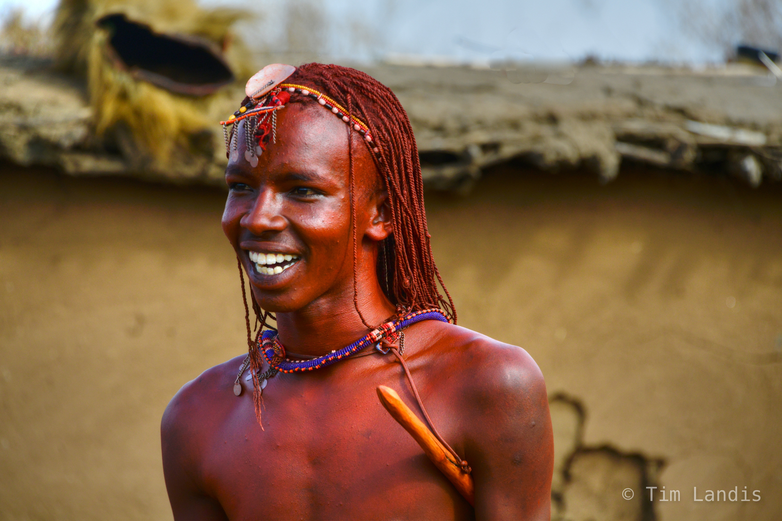 Masi Warrior, cornrows, dreadlocks, hunter gatherer, kenya, perfect teeth, tribesman, warrior in red dust, photo