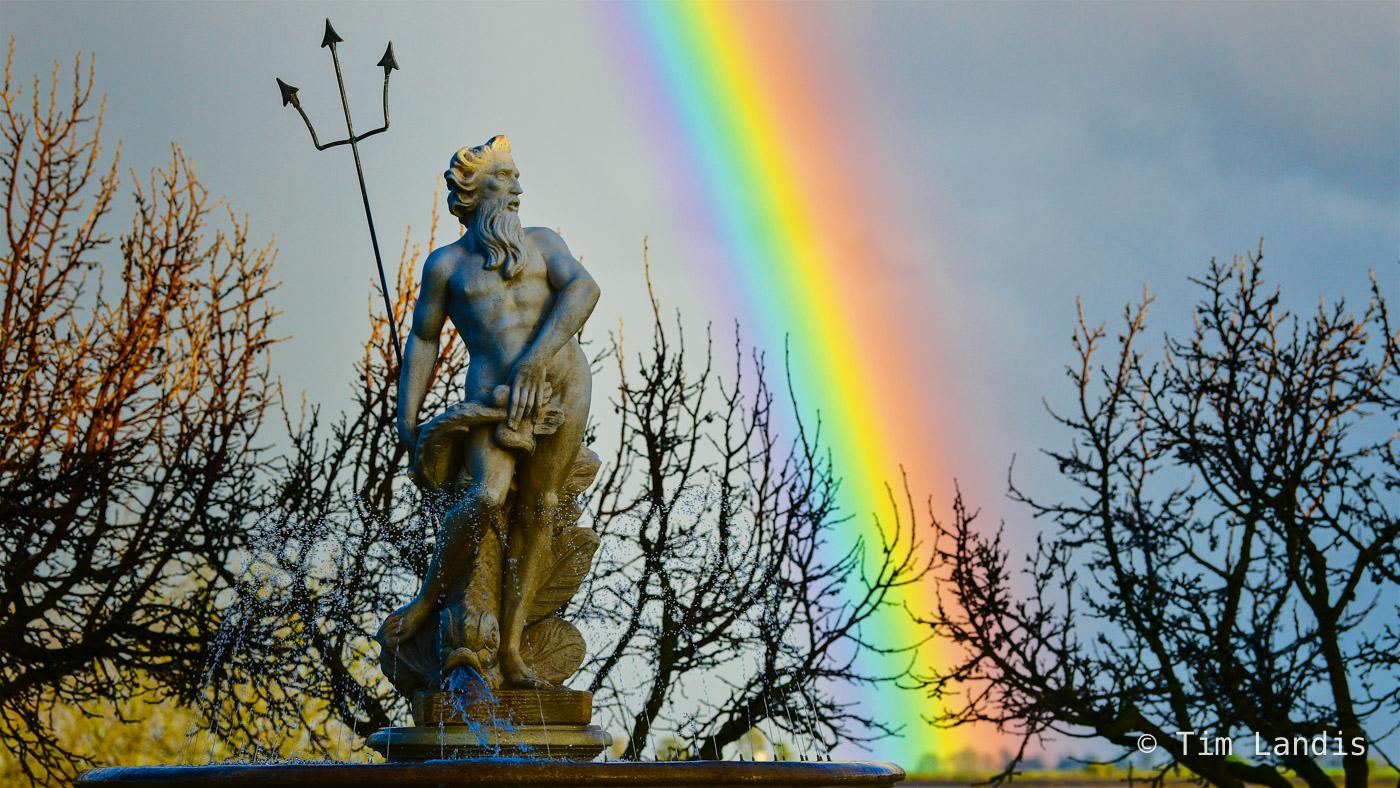 Neptune statue with massive rainbow, photo