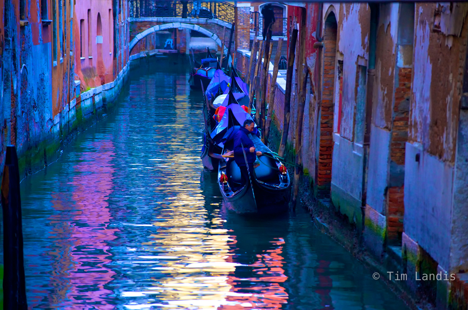 After a busy day, a gondolier parks his gondola